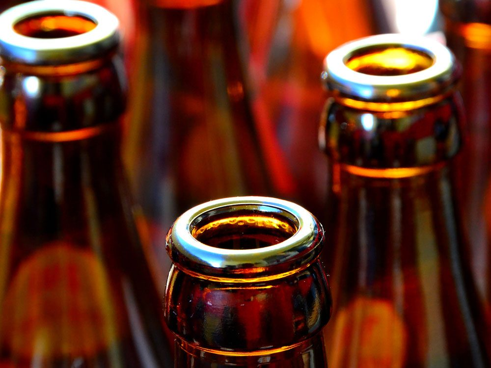 Close-up of empty beer bottles