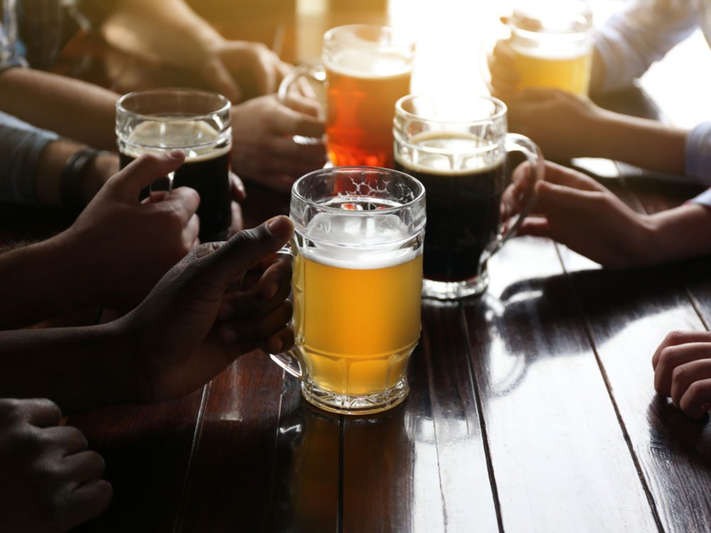 Friends enjoying beer at a local pub