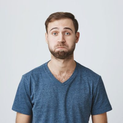 Bearded Caucasian man with confused look on his face