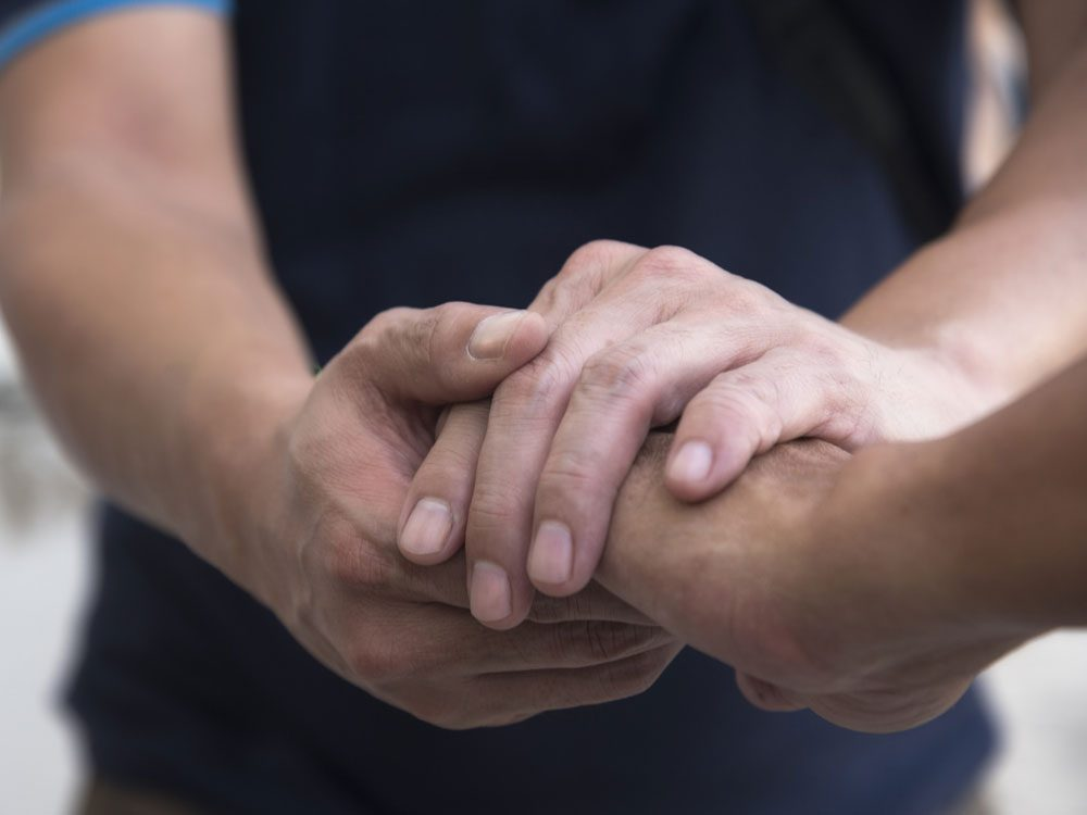 Strangers shaking hands
