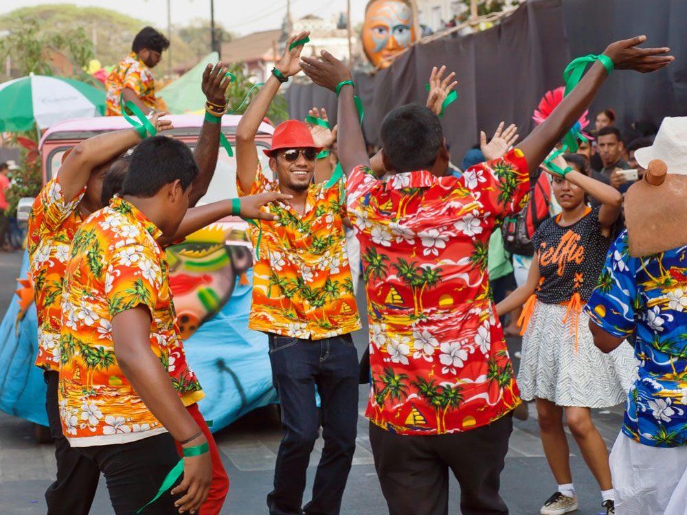 Hawaiian locals dancing at parade