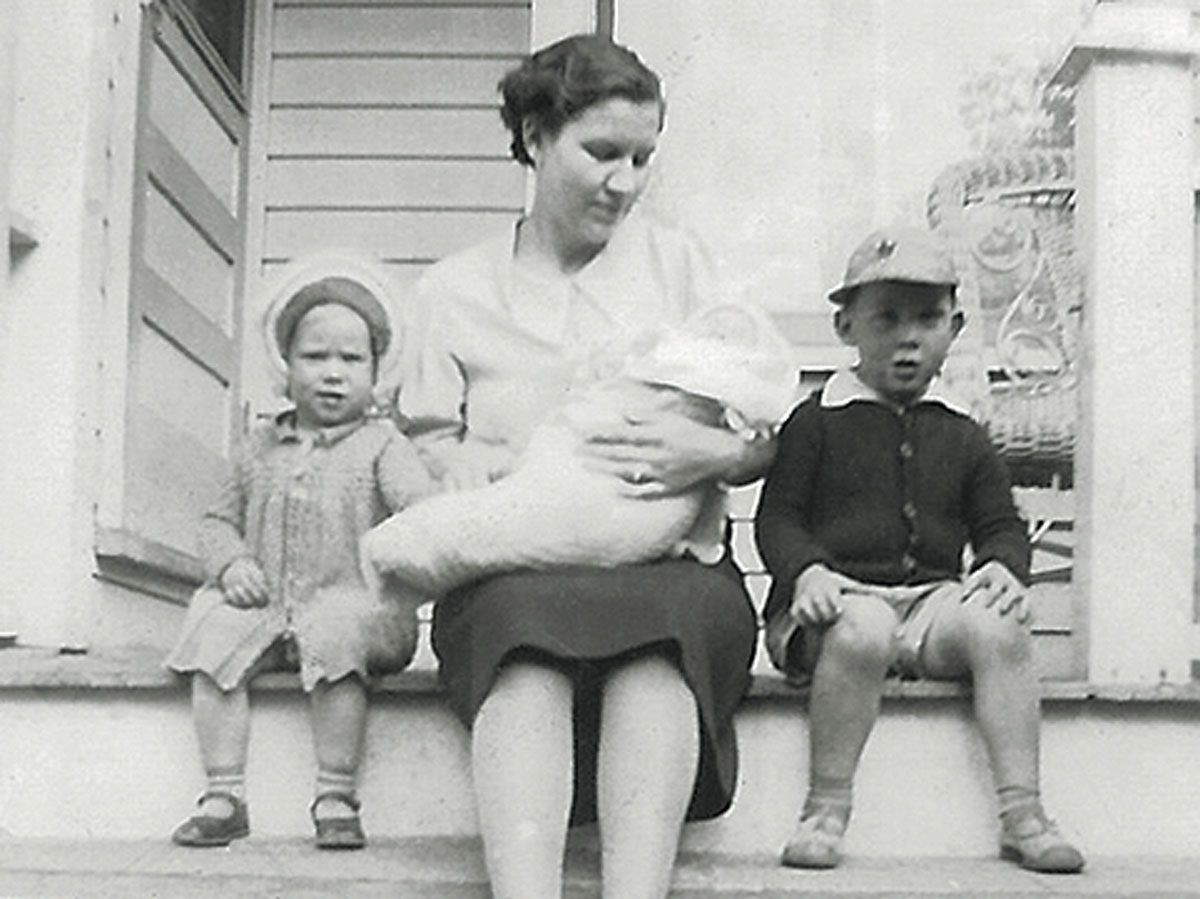 June as a baby in her mother Dorothy's arms, with her sister Noreen and brother Wallace