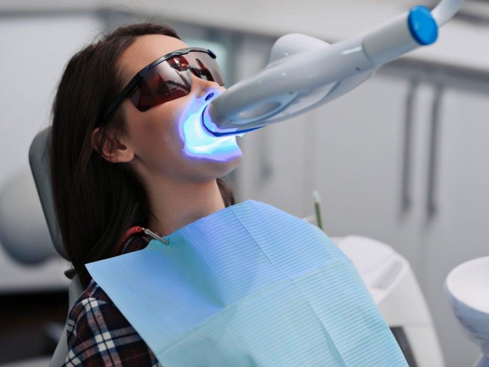 Woman getting her teeth whitened