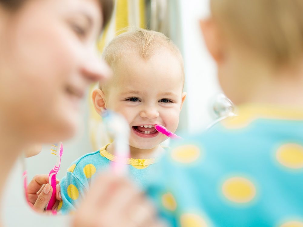 Cute baby boy brushing his teeth