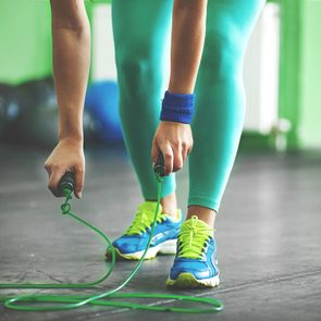 Young fit woman is taking jumping rope