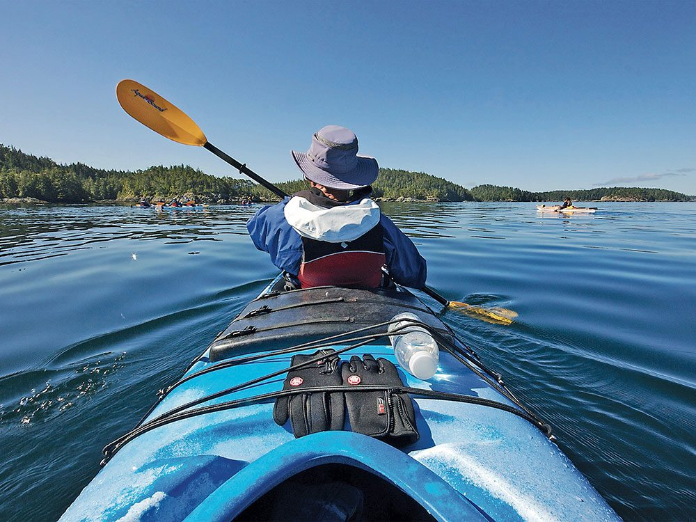 Pamela's dad Brian paddles through the calm waters of Blackfish Sound