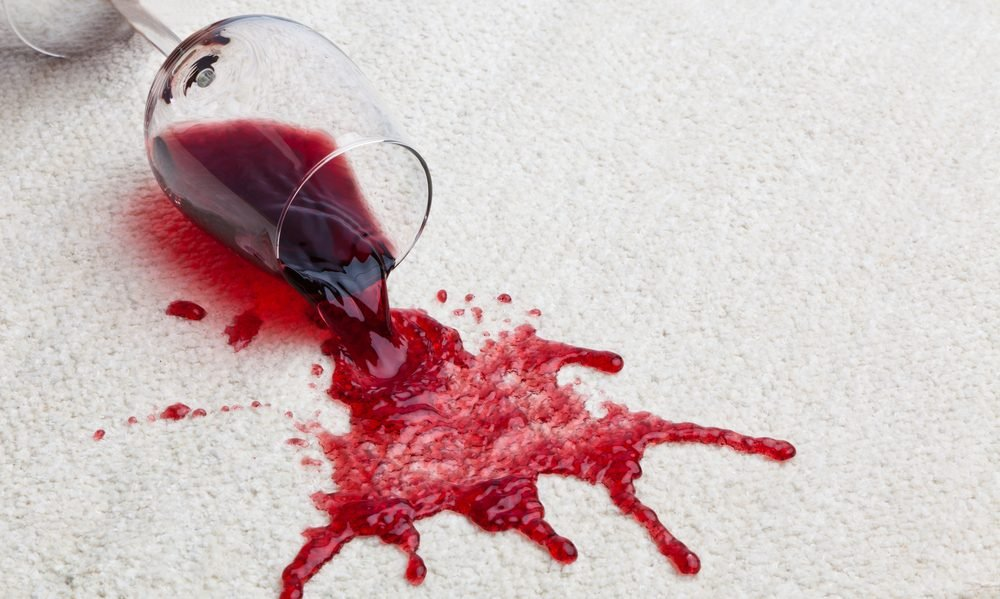 Red wine spill on white carpet