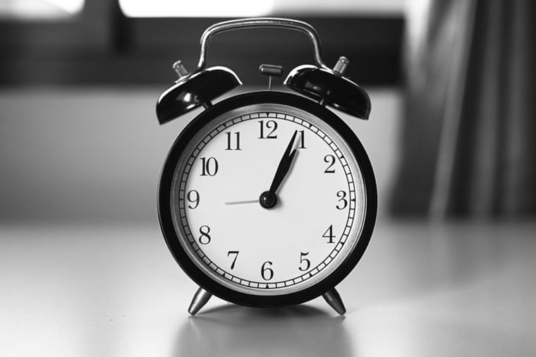 A classic clock in black & white tone with blur background