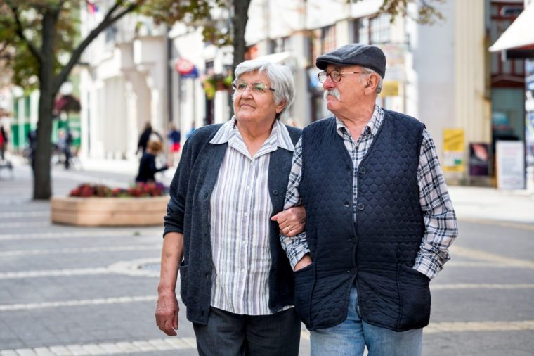 Elderly couple walking