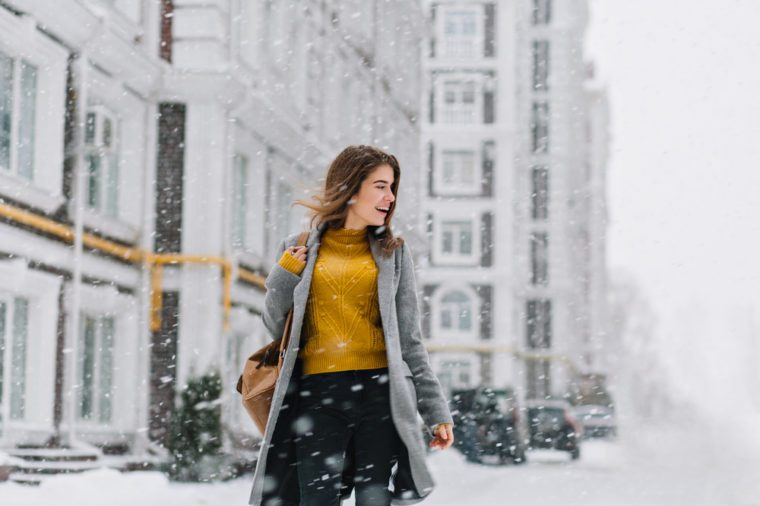 Attractive woman walking in winter street