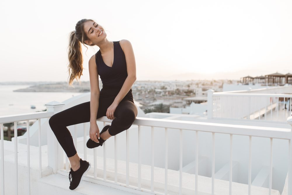 Attractive woman resting after exercise