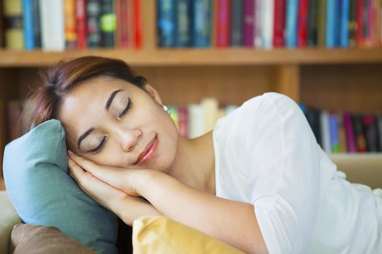 Happy napping woman
