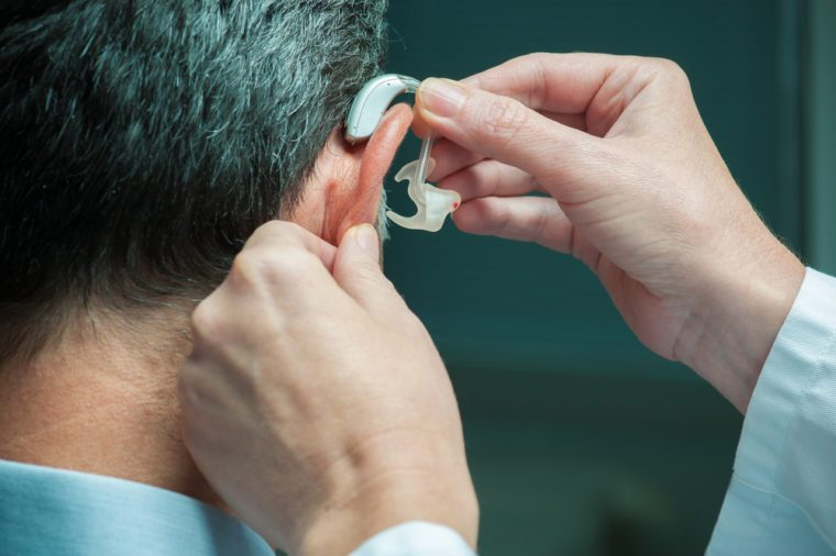 Middle-aged man with hearing aid
