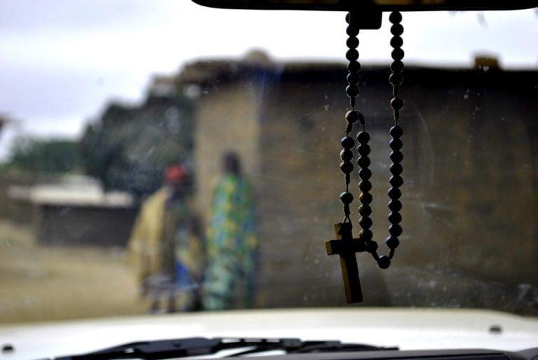 Cross on car mirror in Angola