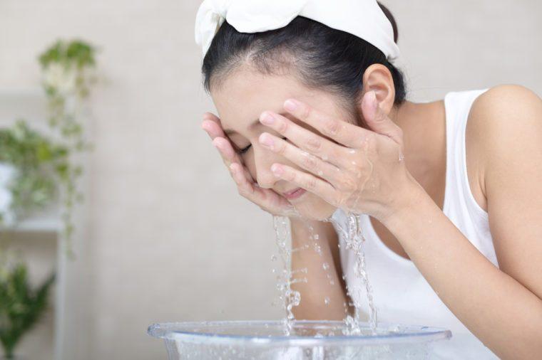 Asian woman washing face