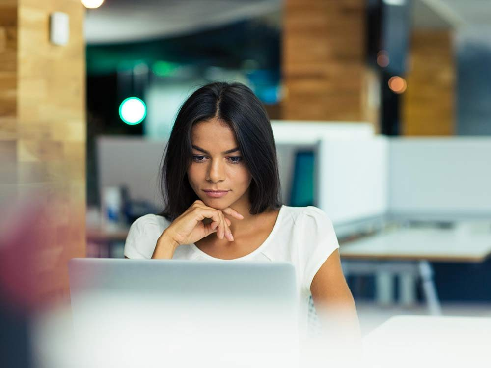 Attractive woman at her desk in office