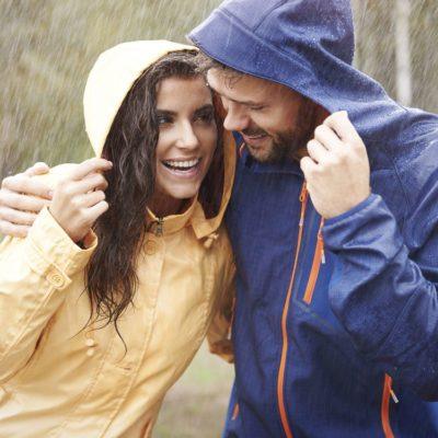 Happy couple in the rain