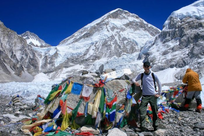 Man standing at the Mount Everest Base Camp (5.380) in Sargamatha National Park, Himalayas, Nepal