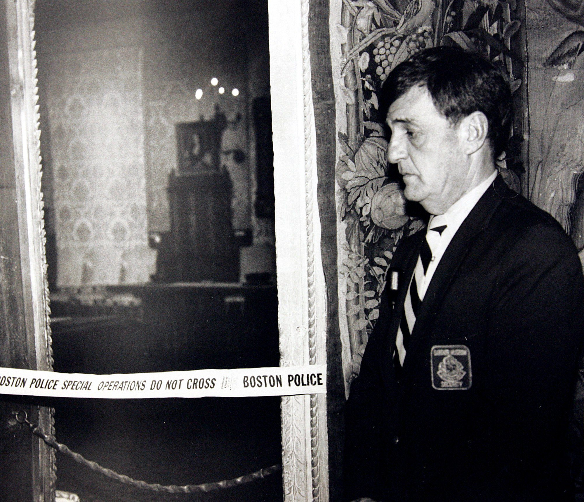 A security guard stands outside the Dutch Room of the Isabella Stewart Gardner Museum in Boston, where robbers stole more than a dozen works of art by Rembrandt, Vermeer, Degas, Manet and others, in an early morning robbery March 18, 1990. The FBI said, it believes it knows the identities of the thieves who stole the art. Richard DesLauriers, the FBI's special agent in charge in Boston, says the thieves belong to a criminal organization based in New England the mid-Atlantic states Art Heist Mystery, Boston, USA