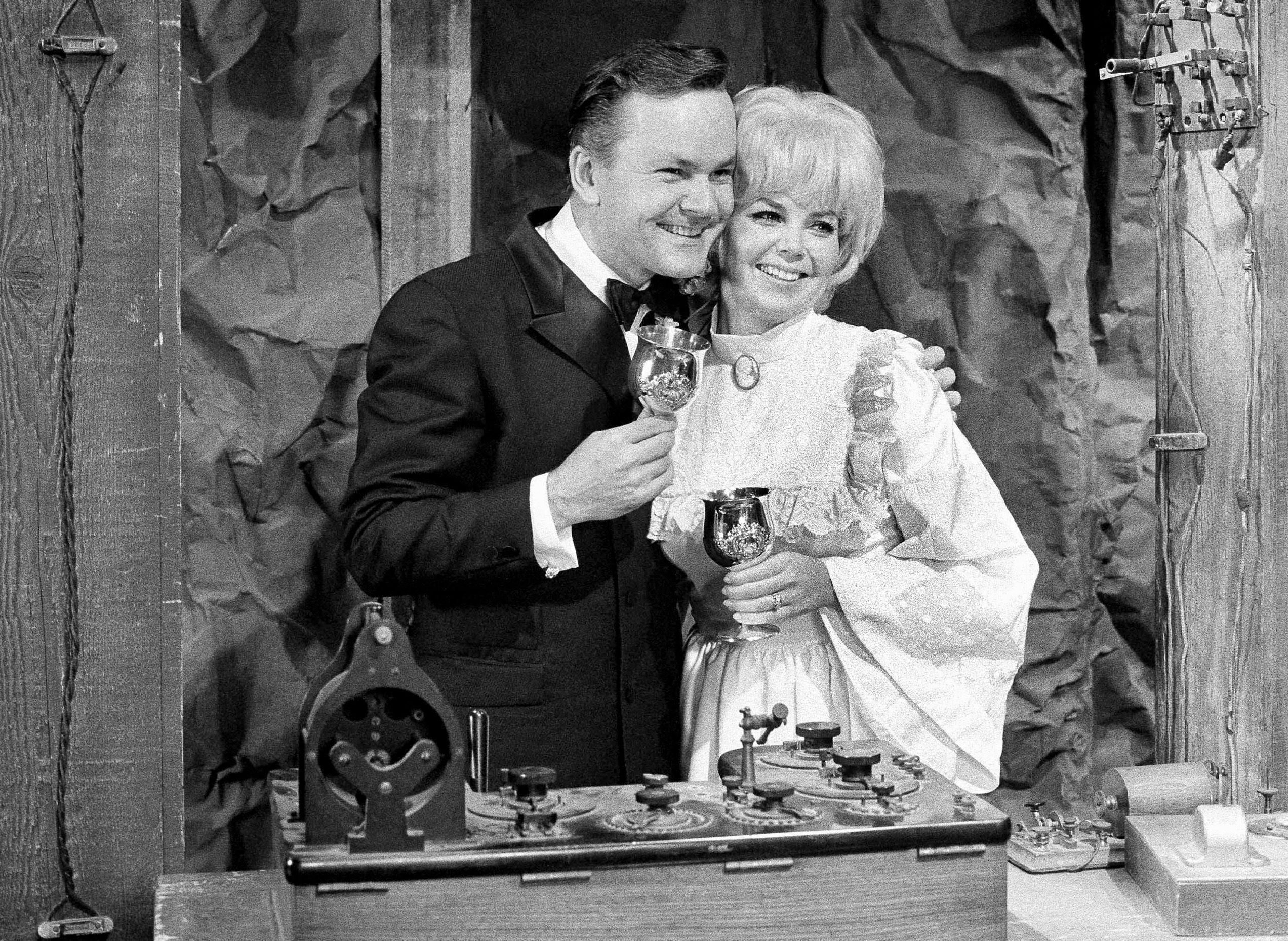 """Actor Bob Crane, star of the television series """"Hogan's Heroes"""", poses with fellow cast member Sigrid Valdis after they were married on the studio set in Hollywood, . Valdis, who played Colonel Klink's secretary on """"Hogan's Heroes"""", died Oct. 14, 2007. Scotty Crane told the Los Angeles Times that his mother died of lung cancer. She was 72 Obit Klinks Secretary, Hollywood, USA"""