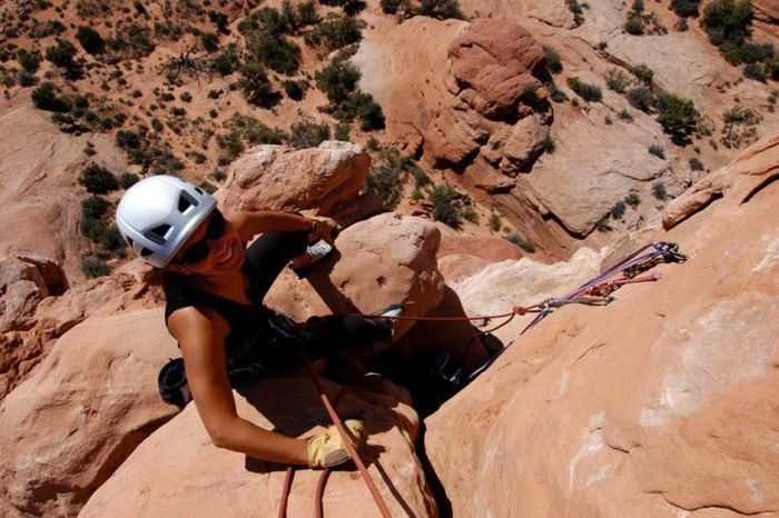 Female rock climber at the belay