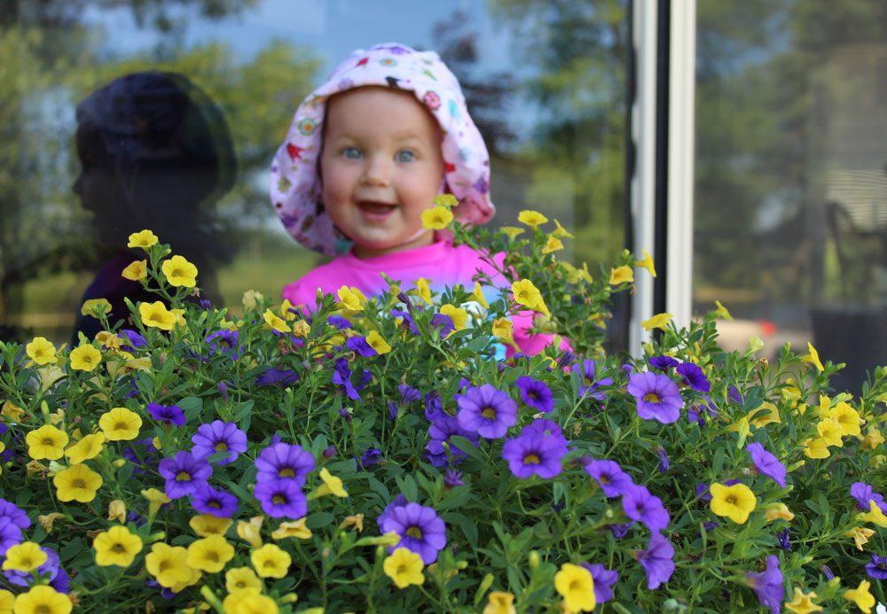 Cute baby girl in her garden