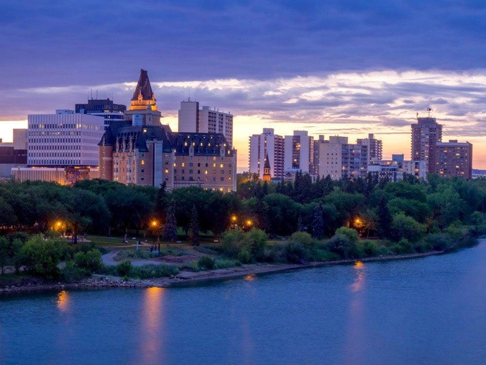 Saskatoon skyline at night along the Saskatchewan River