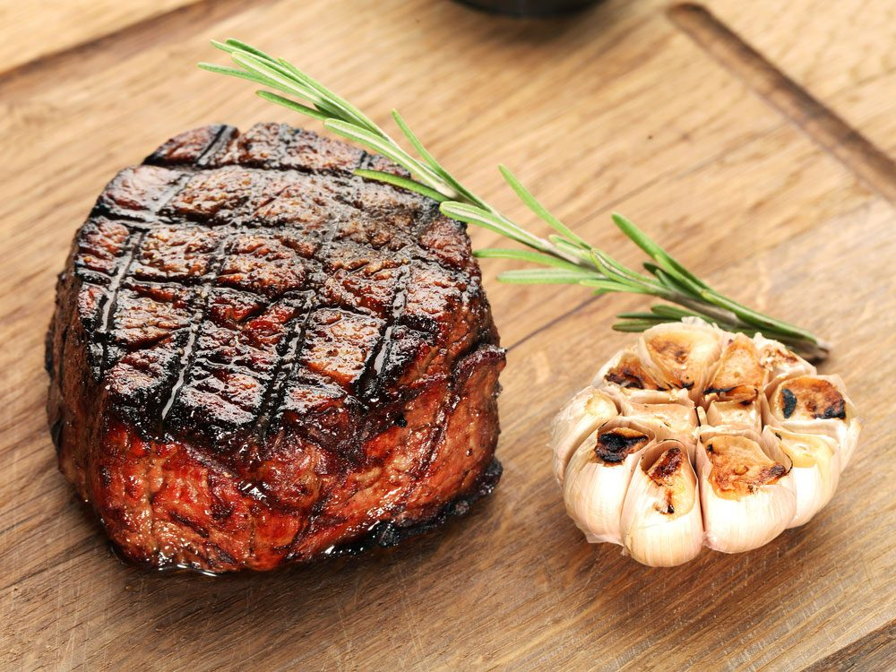Filet mignon with roasted head of garlic