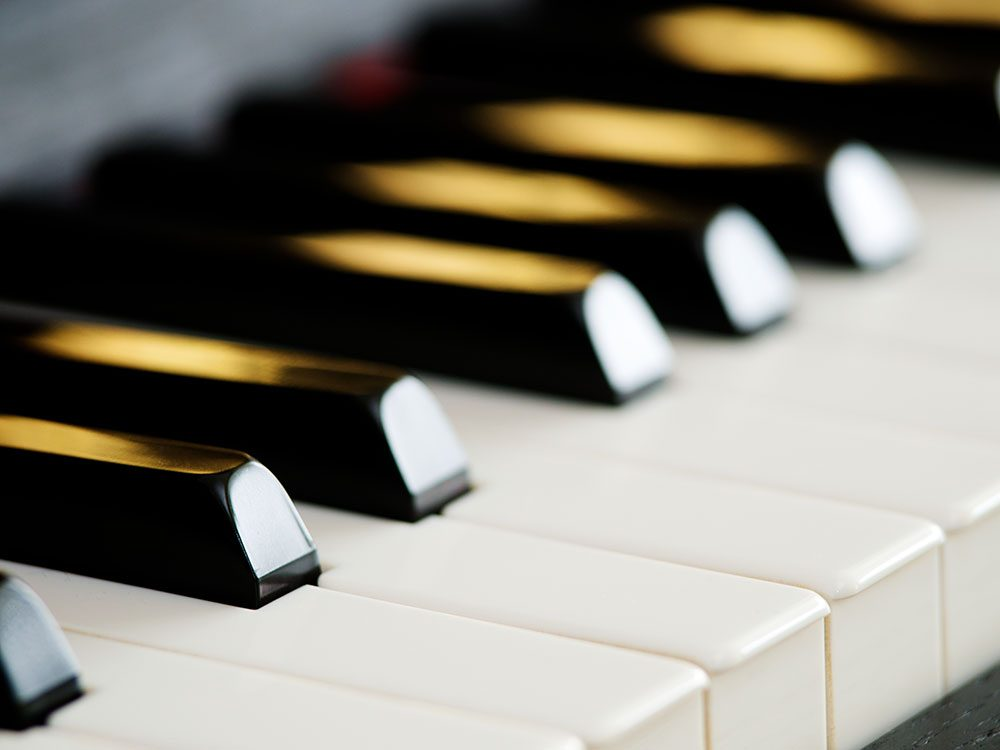 Use pencil erasers to clean piano keys