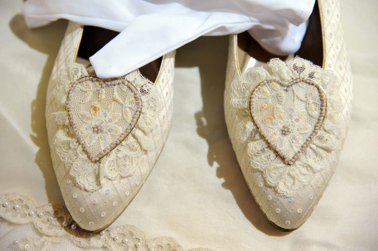 A pair of duplicate wedding shoes fitted to and worn by Princess Diana, 1981, Estimated sale value GBP50-70,000.