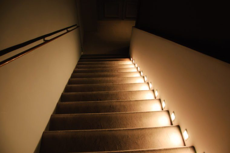 Illuminated stairs in the building. Suspense background.