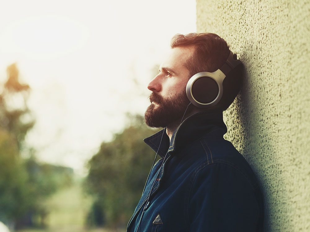 Depressed man listening to music