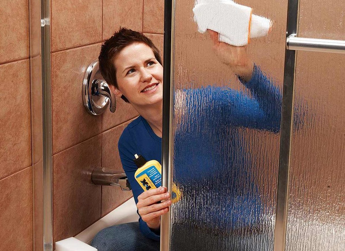 woman cleaning shower
