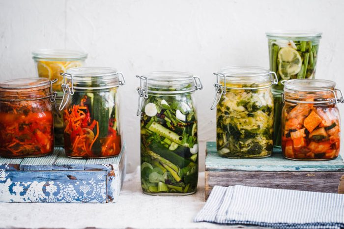 Fermented preserved vegetarian food concept. Cabbage kimchi, broccoli marinated. Canned food concept.