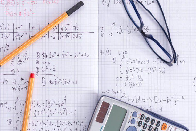 Maths school homework exercise book glasses calculator pens