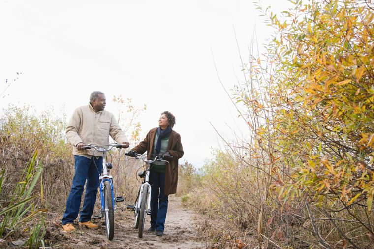 Elderly couple biking