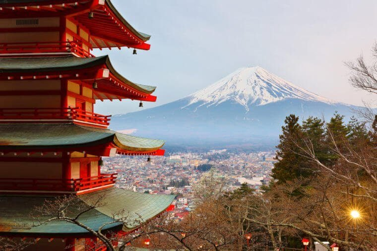 Beautiful Mount Fuji Viewed from behind Chureito Pagoda at Twilight, Fujiyoshida Japan. Chureito pagoda is a five storied pagoda facing Fuji, built as part of Arakura Sengen Shrine in 1963