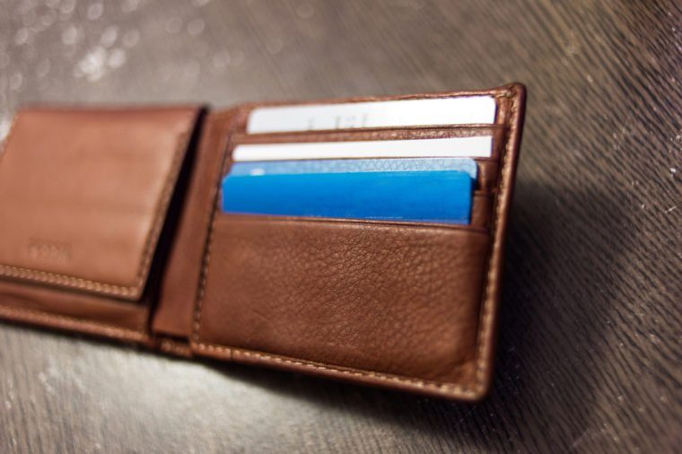 Credit cards in wallet on wood table
