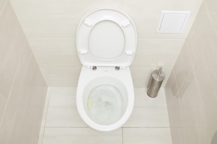 Fushing Toilet. Water drained into the toilet bowl. View from the top