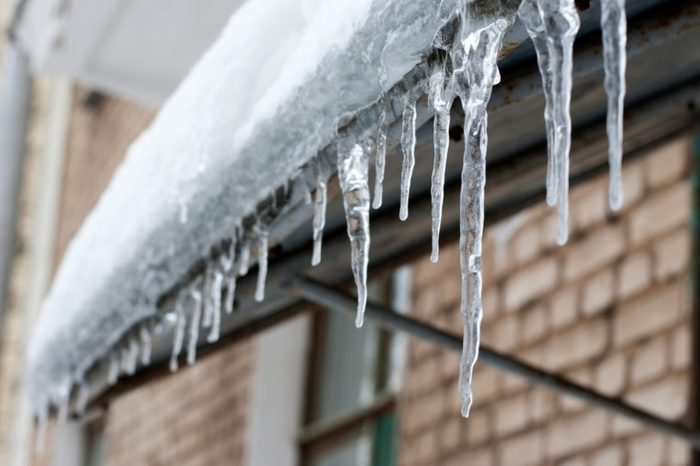 icicles which are hanging down from a roof