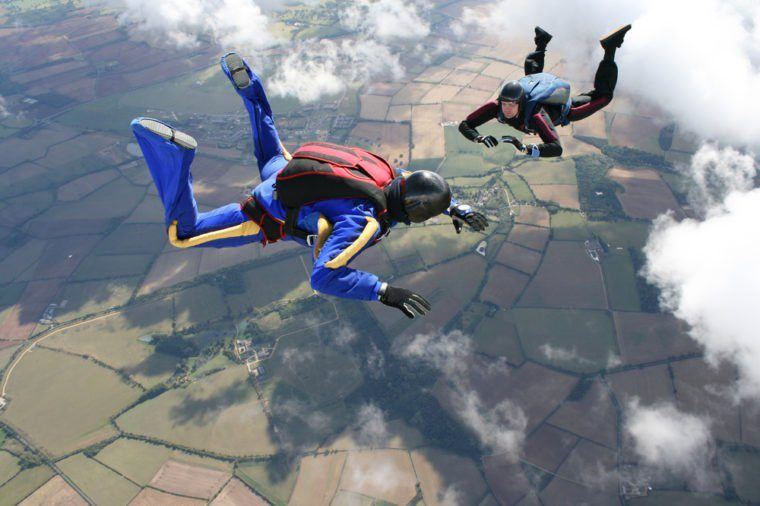 Two skydivers in freefall on a sunny day