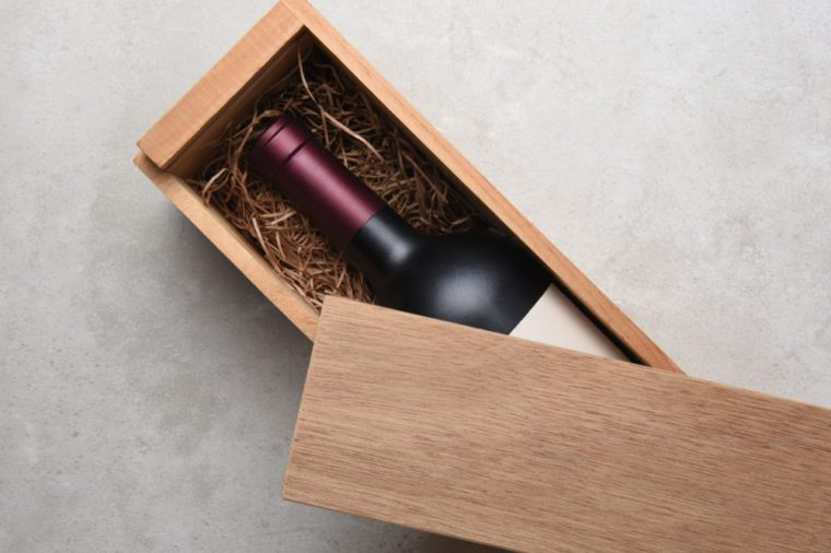 Cabernet Wine Box: A single bottle of red wine in a wood box partially covered by its lid.