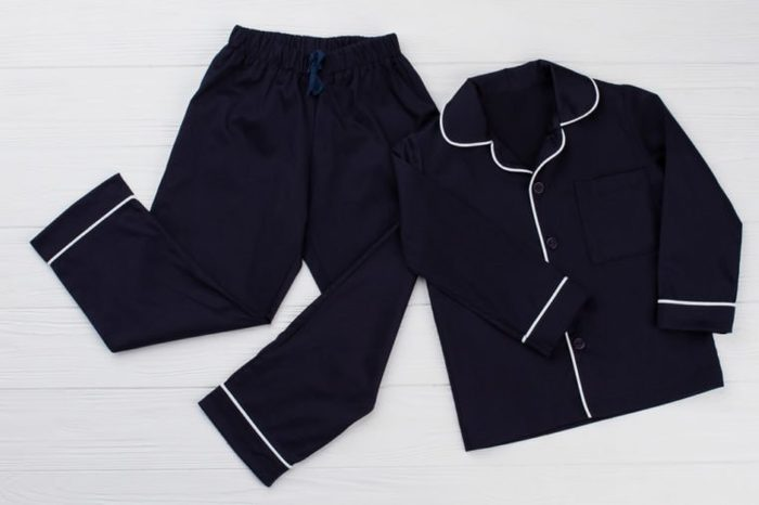 Classic pajama for young boy. Navy shirt and pants decorated with white edging. Simple and elegant.