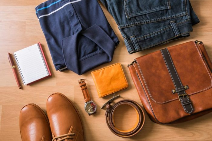 flat lay of men's casual fashion on white wooden floor