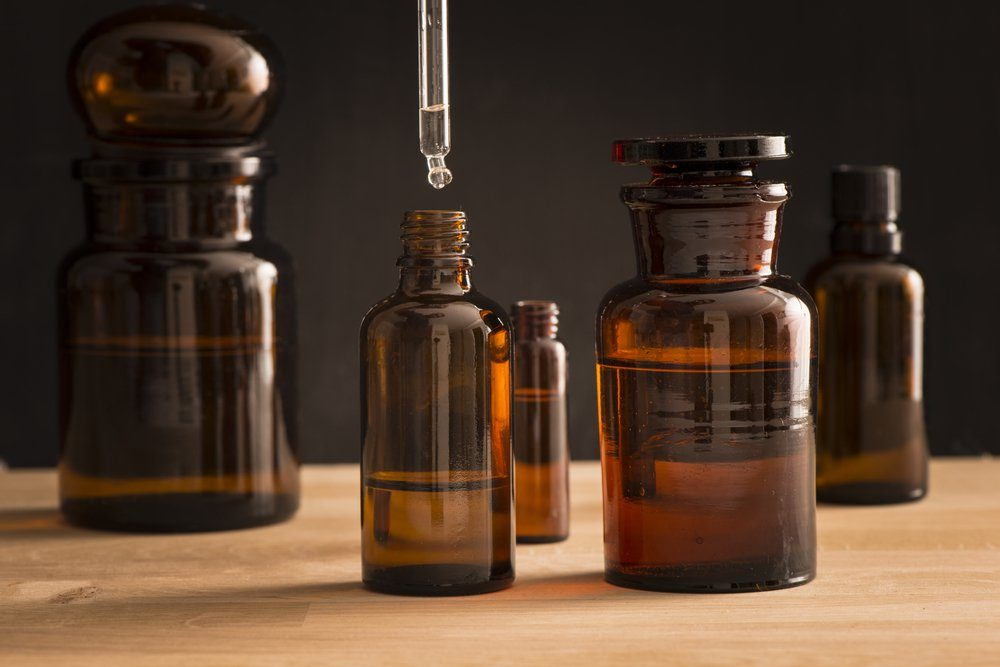 Old style medicine glass bottles. Concept of science research, healthcare and laboratory tests.