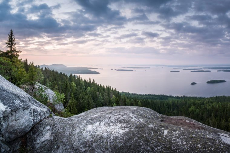 Scenic landscape with lake and sunset at evening in Koli, national park, Finland