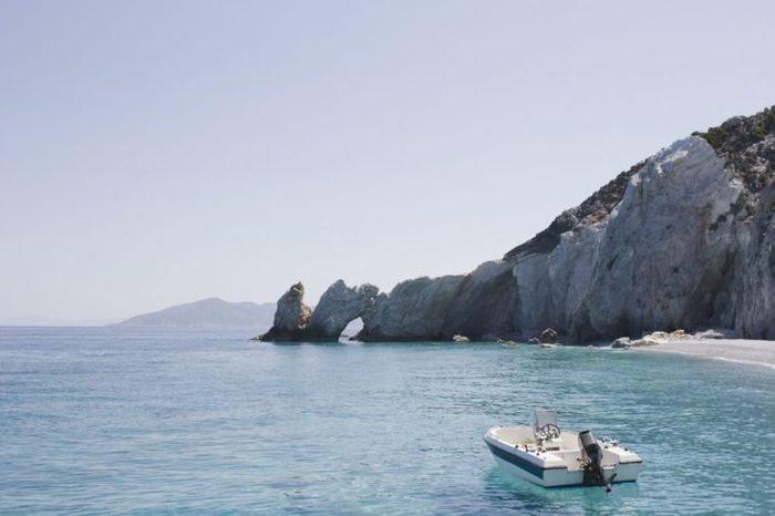 Motorboat mooring off beach, Lalaria Beach, Skiathos, Greece