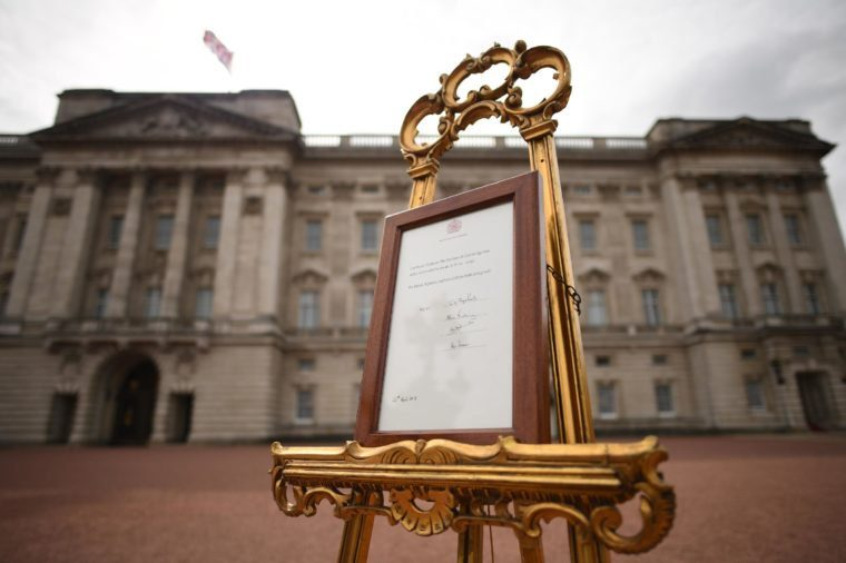 A notice is placed on an easel in the forecourt of Buckingham Palace in London to formally announce the birth of a baby boy to the Duke and Duchess of Cambridge at St Mary's Hospital.
