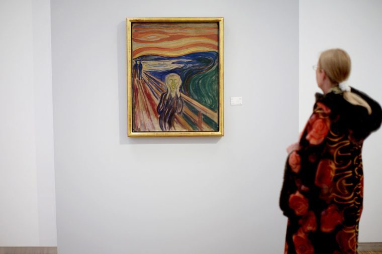 A Visitor Eyes Edvard Munch's Painting 'The Scream' on Display at the Exhibiton 'Scream and Madonna - Revisited' at the Munch Museum in Oslo Norway 23 May 2088 Munch's Works of Art 'The Scream' and 'Madonna' Were Returned to the Munch Museum After Their Theft From the Museum in August 2004 the Paintings Have Been Restored and Conserved and Are Now Back on Display in the Exhibition That Runs Until 26 September 2008 Norway Oslo