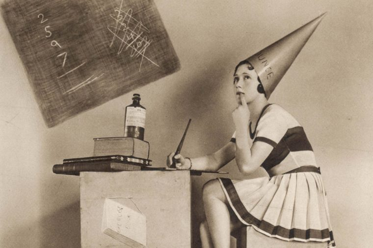 An Amusing Study of Mary Lawson Posed As 'A Most Alluring Little Dunce' Pictured Here in the Sketch in 1931 She Was at the Time Playing Professor Hinzelmann's Beautiful Daughter Gretel in 'White Horse Inn' the Spectacular Tyrolean Musical Play by Erik Charell at the London Coliseum 1931